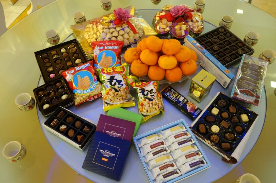 Our tradition of chocolates and mandarin oranges on the morning of Chinese New Year's Day